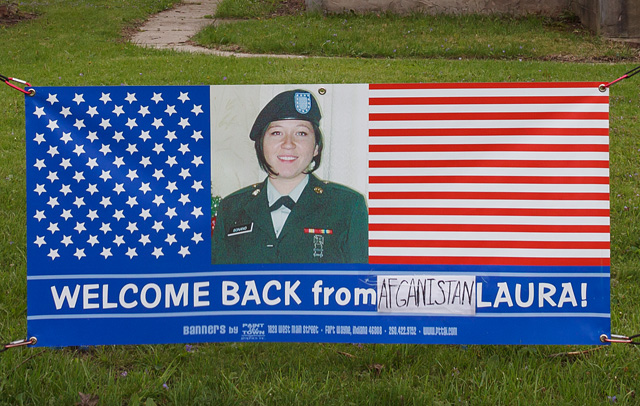 American flag banner that says Welcome Back From Afghanistan Laura.