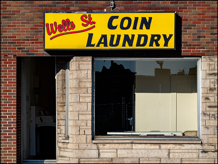 Wells Street Coin Laundry, a laundromat in a tiny brick storefront on Wells Street in Fort Wayne, Indiana.