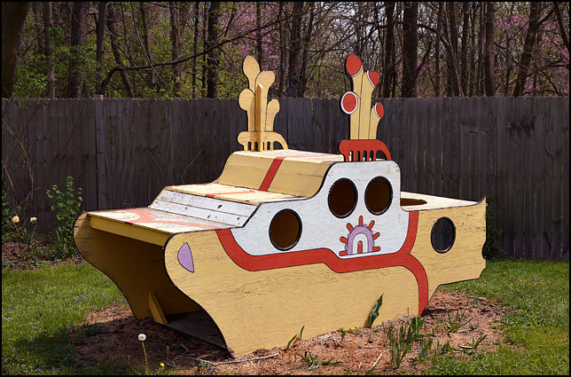 A hand painted plywood replica of the Beatles Yellow Submarine in a front yard on Juliette Avenue in Fort Wayne, Indiana.