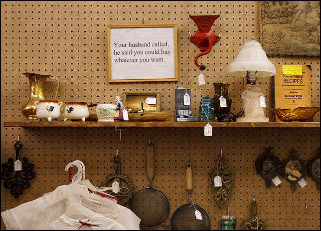 A sign on the wall of Crows Nest Antique Mall in Wabash, Indiana. Your husband called, he says you can buy anything you want.
