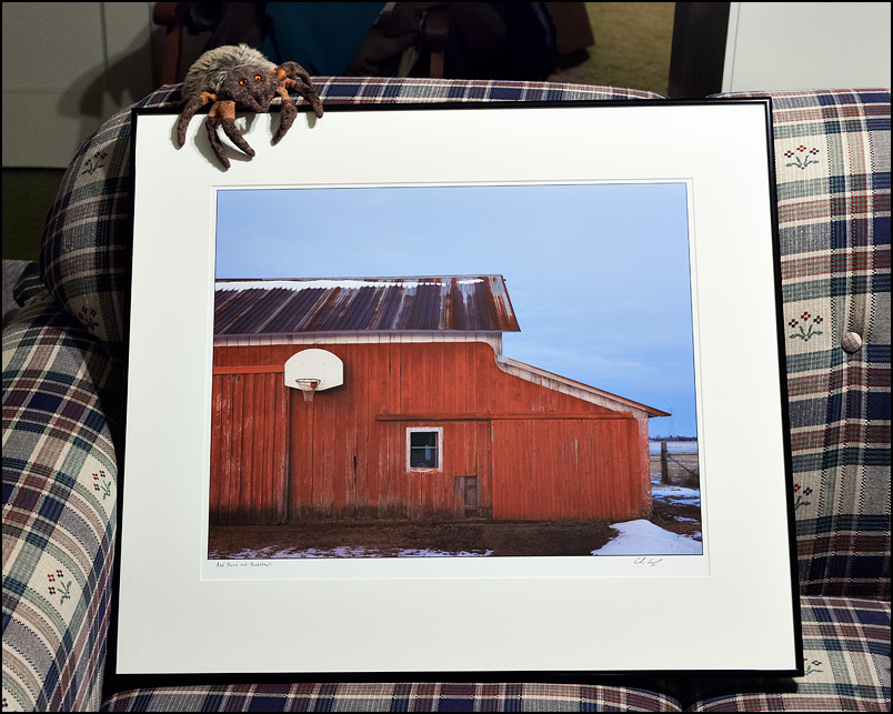 Framed photograph of a red barn with a basketball hoop
