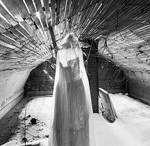 Wedding dress in the attic of an abandoned farmhouse
