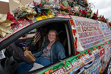 Lynda Farley and her Liberty Van, which is covered in signs advocating for smokers rights and for rightwing causes and conspiracy theories.