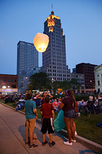A group of teenagers flying a sky lantern at the 2015 Fourth of July fireworks in downtown Fort Wayne, Indiana.