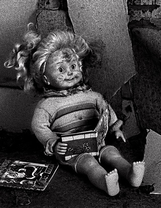 Cricket Doll Reading a book